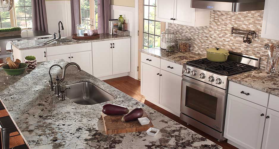 Granite Countertops And White Kitchen Cabinets